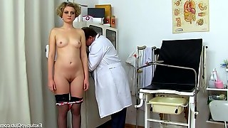 Hot teen in nylons has her deep pussy examined with a speculum