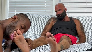 Melancholy black guy makes a friend happy overwrought licking his lay bare feet